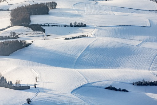 Aerial view of gentle hilly landscape in winter - Klaus Leidorf Aerial Photography