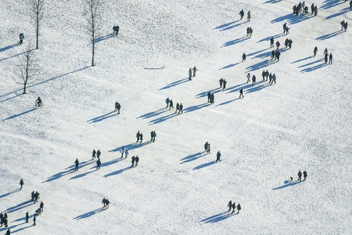 Aerial view of many walkers in the snowy English Garden in Munich - Klaus Leidorf Aerial Photography