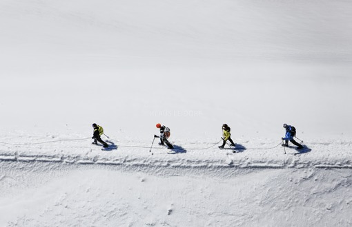 Aerial photo of four mountaineers on the glacier near the summit of the Großvenediger in the Hohe Tauern in Austria - Klaus Leidorf Aerial Photography