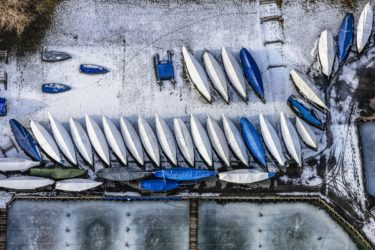 Aerial view of winterproof sailboats in Starnberg harbour - Klaus Leidorf Aerial Photography