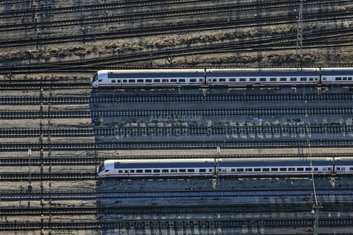 Aerial view of two local trains on the track system in Munich-Aubing - Klaus Leidorf Aerial Photography