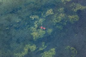 Aerial view of two red air mattresses with bathing guest on the Starnberger See - Klaus Leidorf Aerial Photography