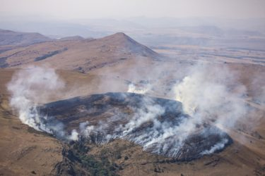 Aerial view of a fire in the dry steppe near Lydenburg in South Africa - Klaus Leidorf Aerial Photography