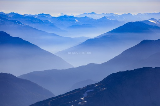 Aerial view from the alpine panorama into the hazy Paznaun valley in Tyrol, Austria - Klaus Leidorf Aerial Photography