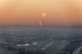 Aerial view of the approach to the commercial airfield Landshut shortly after moonrise - Klaus Leidorf Aerial Photography