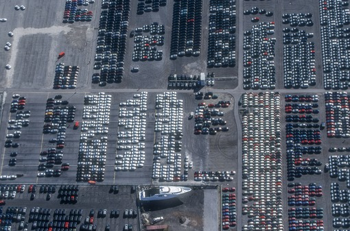 Aerial view of the delivery car park for new vehicles at the port near Kelheim - Klaus Leidorf Aerial Photography
