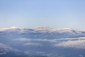 Aerial view of the Bavarian Forest with snow-covered mountains - Klaus Leidorf Aerial Photography