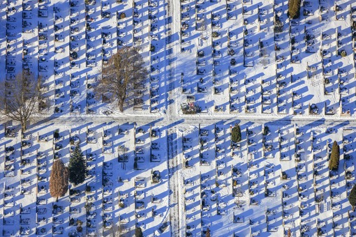 Aerial view of the snow covered cemetery in Moosburg a.d.isar - Klaus Leidorf Aerial Photography