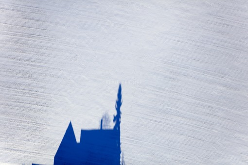 Aerial view of the shadow of a house in the snow-covered field - Klaus Leidorf Aerial Photography