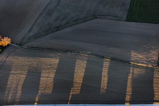 Aerial photograph of the shadow cast by a row of detached houses - Klaus Leidorf Aerial Photography