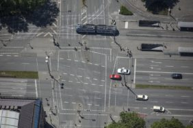 Aerial view of Sendlingertorplatz in Munich with red car - Klaus Leidorf Aerial Photography