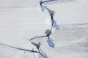 Aerial view of the course of the Pfrombach near Niedererlbach in winter - Klaus Leidorf Aerial Photography