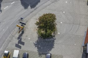 Aerial view of the blossoming chestnut tree in front of the voluntary fire brigade in Buch am Erlbach - Klaus Leidorf Aerial Photography