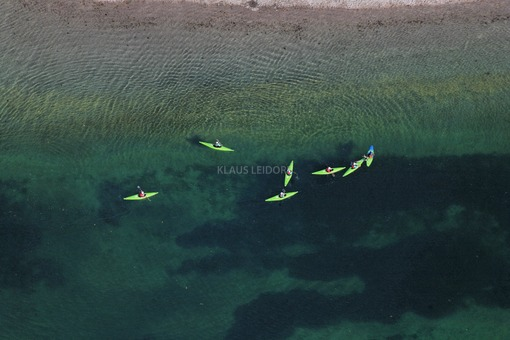 Aerial view of 7 kayaks on a lake near Augsburg - Klaus Leidorf Aerial Photography