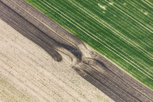Aerial view of farm painting with liquid manure on the field - Klaus Leidorf Aerial Photography