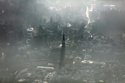 Aerial view of Dingolfing with the church St.Johannes in the back light at haze - Klaus Leidorf Aerial Photography