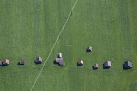Aerial view of field barns on meadows near Mittenwald - Klaus Leidorf Aerial Photography