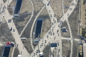 Aerial view of football fans on their way to the Allianz Arena stadium in Munich - Klaus Leidorf Aerial Photography