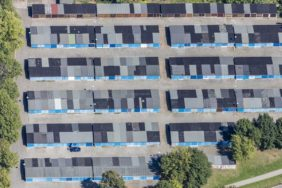 Aerial view of garages with blue gates - Klaus Leidorf Aerial Photography