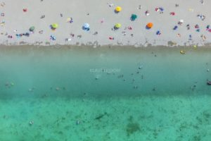 Aerial view of people on the beach of Riemer See - Klaus Leidorf Aerial Photography