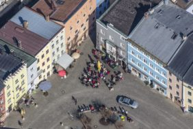 Aerial view of people in the old town of Wasserburg am Inn - Klaus Leidorf Aerial Photography