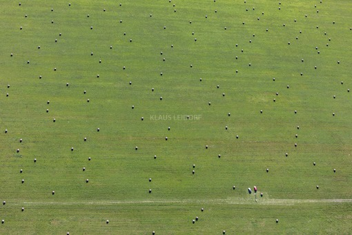 Aerial view of model planes between straw rolls - Klaus Leidorf Aerial Photography