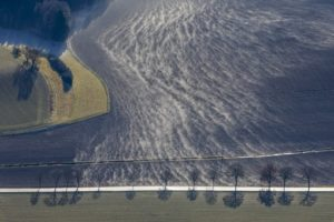 Aerial view of wafts of mist over farmland - Klaus Leidorf Aerial Photography