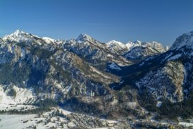Aerial view of Neuschwanstein Castle in front of the snow-covered Alps - Klaus Leidorf Aerial Photography