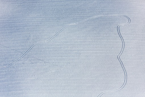 Aerial view of tracks on the snow-covered field - Klaus Leidorf Aerial Photography