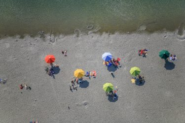 Aerial view of beach visitors at Riemer See - Klaus Leidorf Aerial Photography
