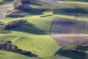 Aerial view of waves in the landscape in the evening light - Klaus Leidorf Aerial Photography