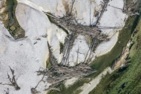 Aerial view of driftwood washed up on a gravel bank in the Isar - Klaus Leidorf Aerial Photography