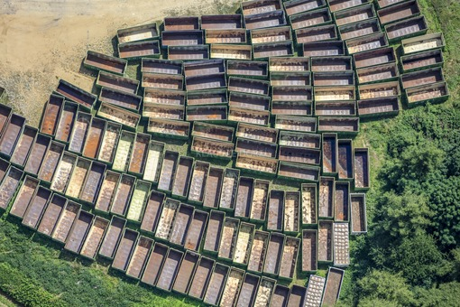 Aerial view of lined up empty containers of the disposal company Högl in Volkenschwand - Klaus Leidorf Aerial Photography