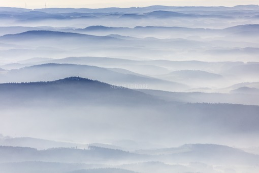 Aerial view of the mountain Haidstein in the haze of the Bavarian Forest - Klaus Leidorf Aerial Photography