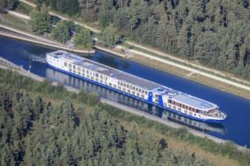 Aerial view of the river cruise ship MS Belvedere shortly behind the lock Eibach of the Main-Danube-Canal in the south of Nuremberg - Klaus Leidorf Aerial Photography