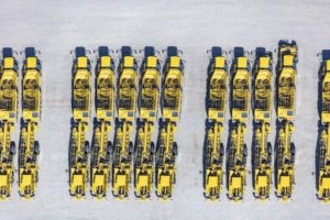 Aerial view of the agricultural machines Ropa beet harvesters and beet cleaning loaders in Sittelsdorf - Klaus Leidorf Aerial Photography