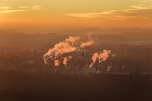 Aerial view of the evening mood over Moosburg with the smoking chimneys of the local Südchemiefabrik - Klaus Leidorf Aerial Photography