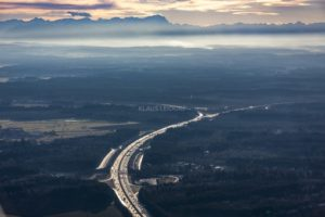 Aerial view from the motorway A99 in the direction of Alpen and Zugspitze in foehn weather - Klaus Leidorf Aerial Photography