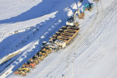 Aerial view of the construction site of the motorway A94 through the Isental in winter - Klaus Leidorf Aerial Photography