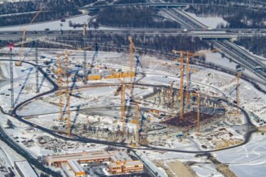 Aerial view of the construction site of the Allianz Arena football stadium in Munich-Fröttmaning - Klaus Leidorf Aerial Photography