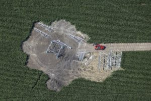 Aerial photograph of the construction site in a maize field on a power pole for a high-voltage line - Klaus Leidorf Aerial Photography
