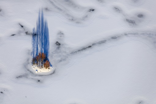 Aerial view of the island in the frozen Satzdorf lake - Klaus Leidorf Aerial Photography