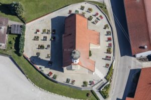 Aerial view of the church in Außerbittelbach in the cemetery - Klaus Leidorf Aerial Photography