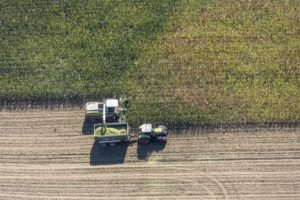 Aerial view of the maize harvest with the chopper - Klaus Leidorf Aerial Photography