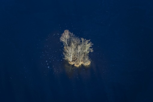 Aerial view of the small island in the frozen Großer Kesselsee - Klaus Leidorf Aerial Photography