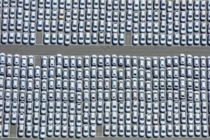 Aerial photograph of a parking area for about 1000 new Audi brand vehicles in an industrial area near Schwandorf - Klaus Leidorf Aerial Photography