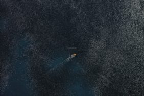Aerial view of a bodyboarder against the light - Klaus Leidorf Aerial Photography