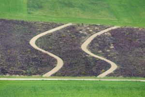 Aerial view of a field with two parallel curve tracks - Klaus Leidorf Aerial Photography