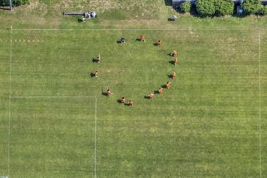 Aerial view of a football training in a circle - Klaus Leidorf Aerial Photography