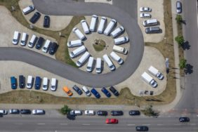 Aerial view of an industrial area with car dealership - Klaus Leidorf Aerial Photography